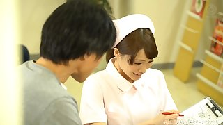 Asian nurse Airi Suzumura jerks a long dick until he cums