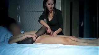 Bonny asian youthful slut giving a handjob