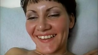 Naughty mom MILF stuffing shaved pussy with big dildo close up